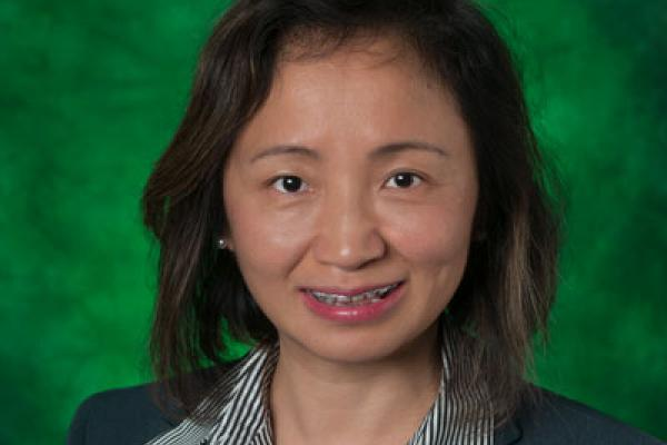Yan Huang named distinguished member of Association for Computing Machinery